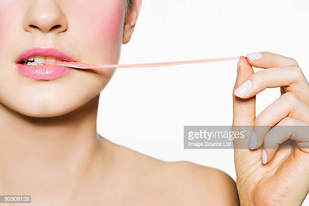 Woman pulling gum out of her mouth
