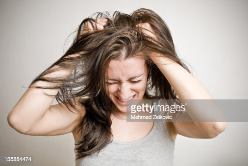 Woman pulling her hair : Stock Photo