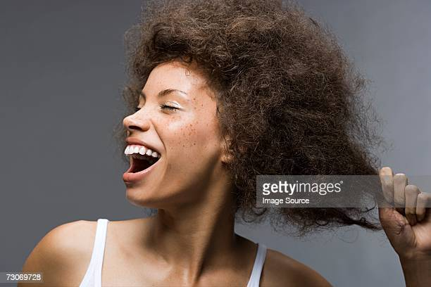 Woman pulling her hair