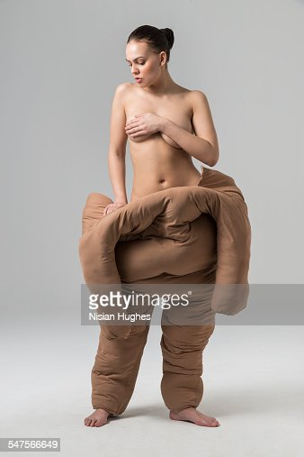 Woman pulling off fat suit