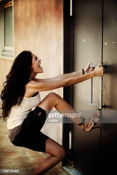 Woman Pulling on Doors Trying to Open