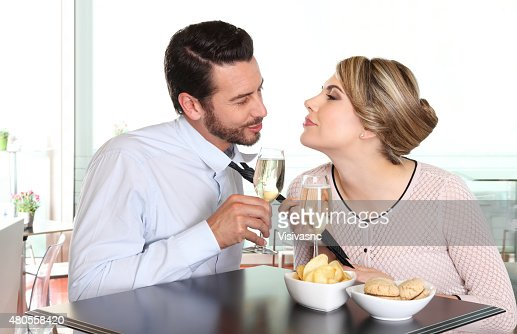woman pulling the tie to boyfriend, couple love concept : Stock Photo