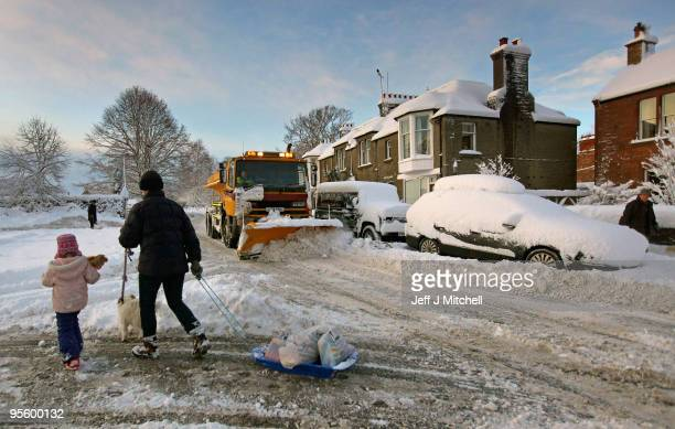 A woman pulls shopping on a sledge in the Scottish Borders village of St Boswells on January 6 2009 in St Boswells Scotland Extreme weather warnings...