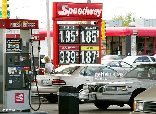 A woman pumps gas into her car at a Speedway gas station June 22 2004 in Des Plaines Illinois The average price of gasoline in the US has fallen for...