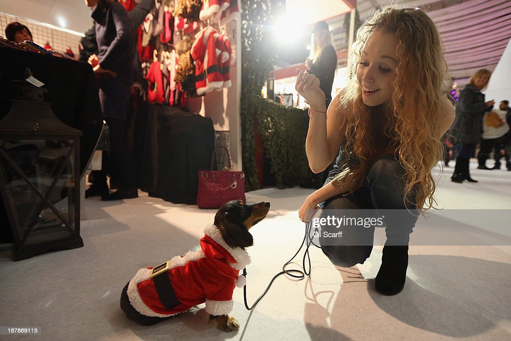 A woman purchases a Christmas outfit for her dog 'Monza' at the 'Ideal Home Show at Christmas' on November 13, 2013 in London, England. Over 80,000 visitors are expected to attend the 5 day event which showcases a range of gift ideas for Christmas in the Earls Court exhibition centre.