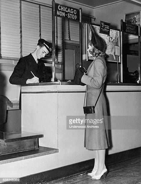 A woman purchases a nonstop ticket to Chicago on American Airlines circa 1937