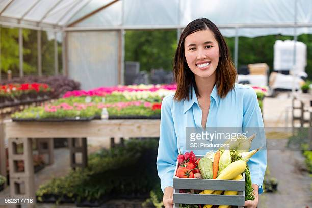 Woman purchases fresh veggies at farmer's market