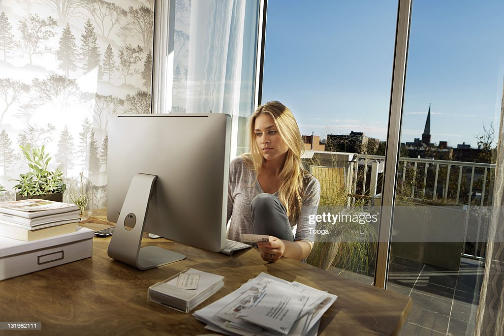 Woman purchasing online : Stock Photo