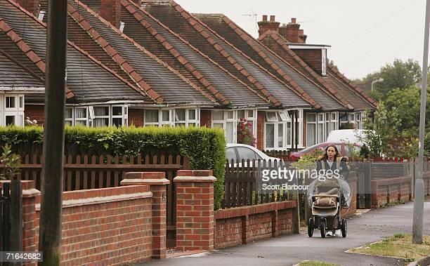 A woman pushes a pram as she walks down the street on August 14 2006 in High Wycombe England Detectives are conducting a major search for evidence at...