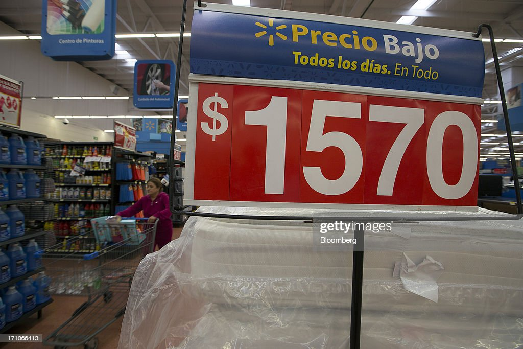 A woman pushes a shopping cart past mattresses displayed for sale at a Wal-Mart Stores Inc. location in Mexico City, Mexico, on Thursday, June 20, 2013. Mexican retail sales rose 2.5 percent in April from the same month last year, the country's statistics agency, known as Inegi, reported on its website. Photographer: Susana Gonzalez/Bloomberg via Getty Images