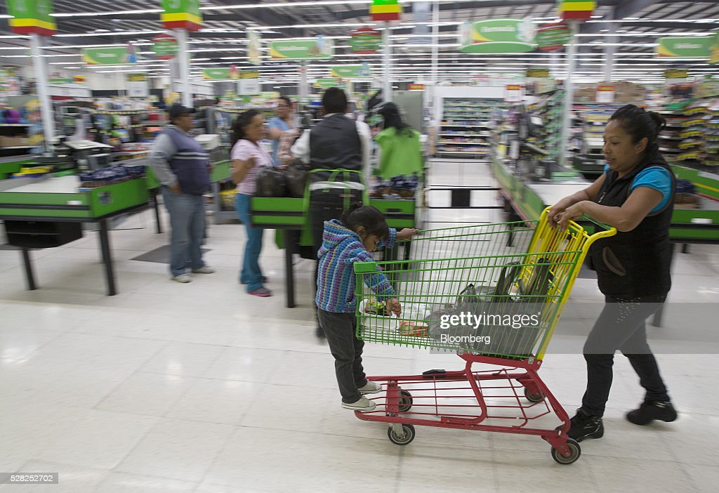A woman pushes a shopping cart with a young child at a Bodega Aurrera store, the discount chain owned by Wal-Mart Stores Inc., in Naucalpan de Juarez, Mexico, on Wednesday, May 4, 2016. Wal-Mart de Mexico SAB reported first-quarter results last week that beat analysts estimates, the most recent sign of growth for Mexican companies this earnings season. Photographer: Susana Gonzalez/Bloomberg via Getty Images