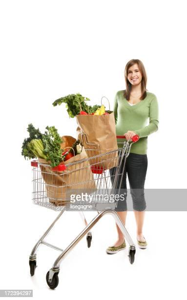 Woman pushing a shopping cart containing grocery