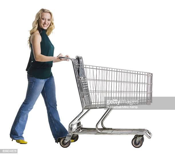 woman pushing a shopping cart