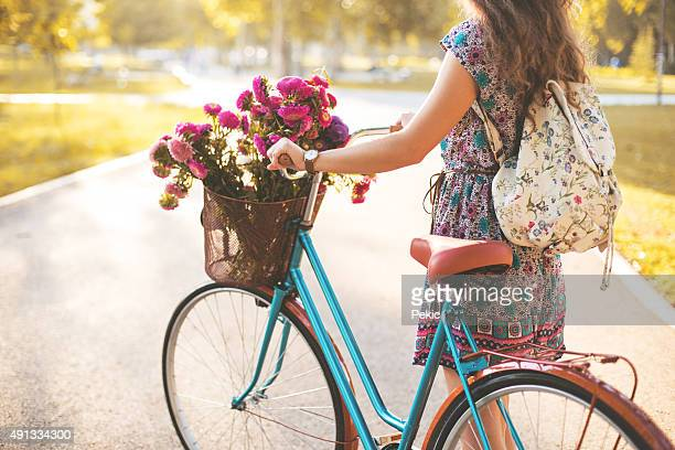 Woman pushing bicycle