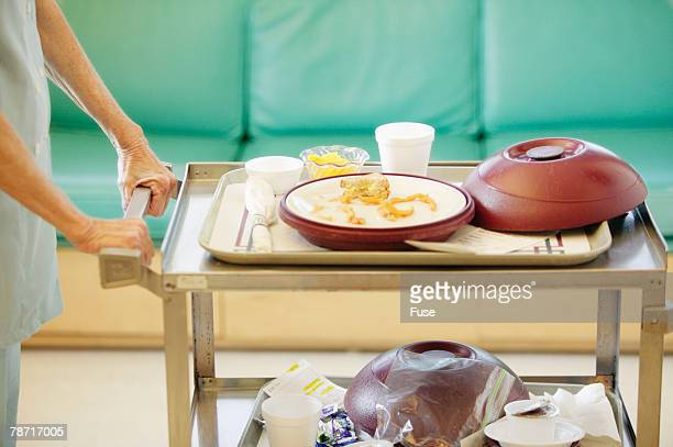 Woman Pushing Cart with Meals