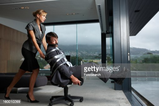 Woman Pushing Man Tied Up In Chair Stock Photo Getty Images