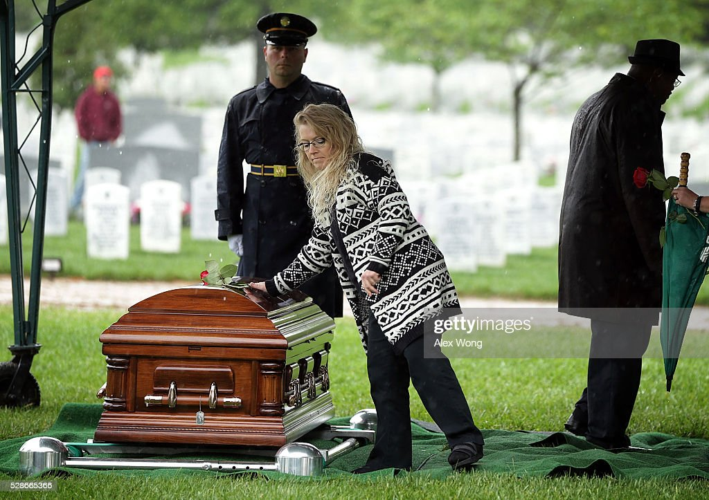A woman put down a rose on the casket during the funeral of Army Corporal David J. Wishon at Arlington National Cemetery May 6, 2016 in Arlington, Virginia. Corporal Wishon was assigned to a medical unit in the 7th Infantry Division when he went missing after an attack on Dec. 1, 1950 in the Korean War.