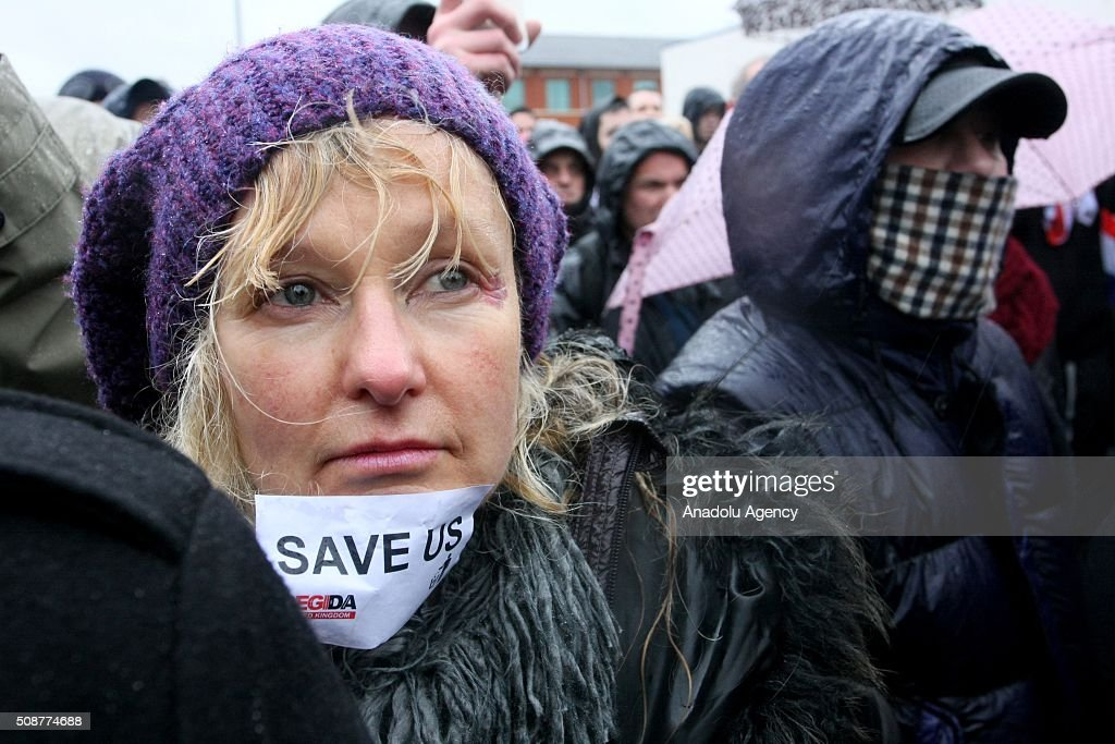 A woman puts a sticker on her chin during the 'silent march' organized by Pegida (Patriotic Europeans against the Islamisation of the West) UK supporters in Birmingham, England on February 6, 2016.