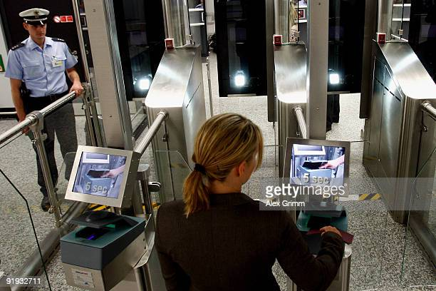 A woman puts her passport into a reader during the presentation of the new automated border control system easyPass at Frankfurt International...