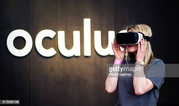 A woman puts on the HeadMounted Display Oculus Rift on February 24 2016 in Berlin Germany Facebook presented its Innovation Hub where new technology...