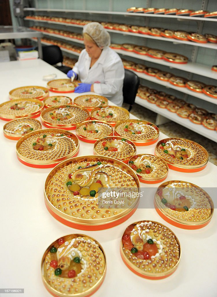A woman puts the finishing touches to a traditional hand made 'Anguila' (eel shaped) mazapan christmas cake at the Santo Tome Obrador de Mazapan cake bakery on November 28, 2012 in Toledo, Spain. The company, which employs 45 staff throughout the year, has hired an extra 25 workers leading up to the christmas festivities hoping comsumption picks up over the holiday period.