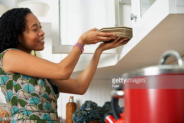Woman Putting Dishes Away