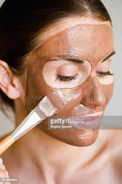 Woman putting face mask on