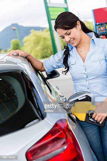 Woman putting fuel in the car