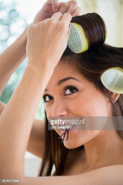 Woman putting her hair up in curlers