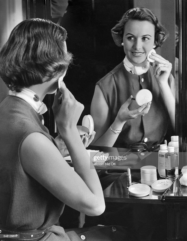 Woman putting on makeup in front of the mirror - 1961 - Vintage ...