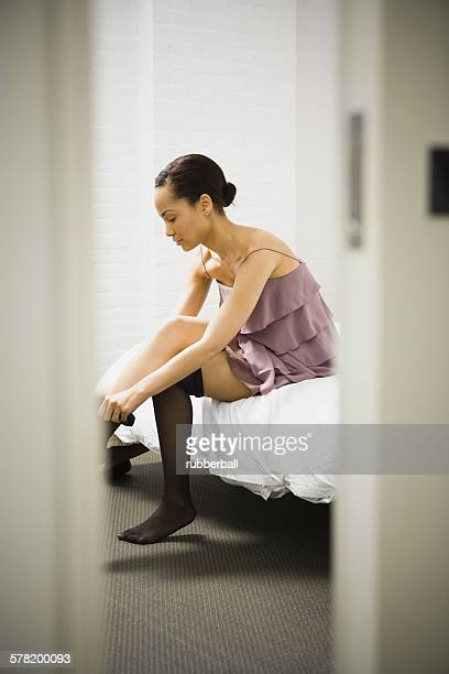 Putting On Nylons Stock Photos And Pictures