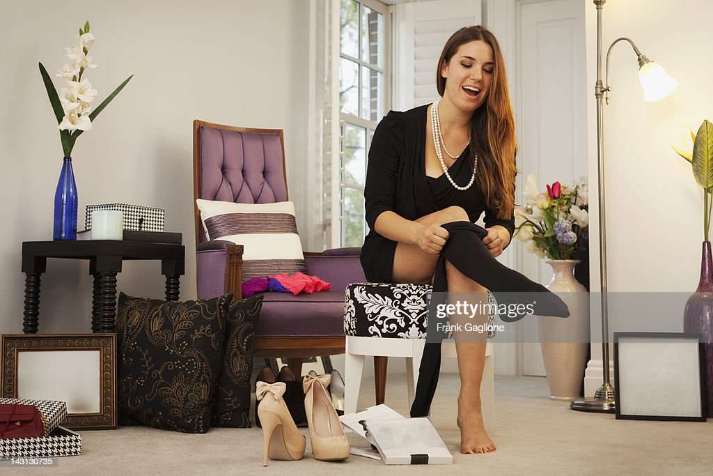 Woman putting on tights.