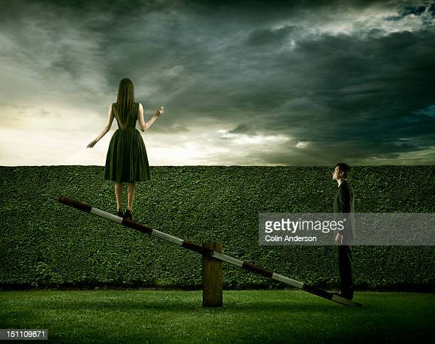 A woman raised by a man on a see-saw