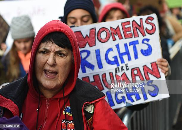 Woman rally as part of a nationwide protest against US Presidentelect Donald Trump outside of Trump Tower on December 12 2016 in New York / AFP /...
