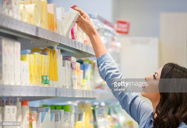 Woman reaching for beauty products