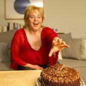 Woman reaching for cake