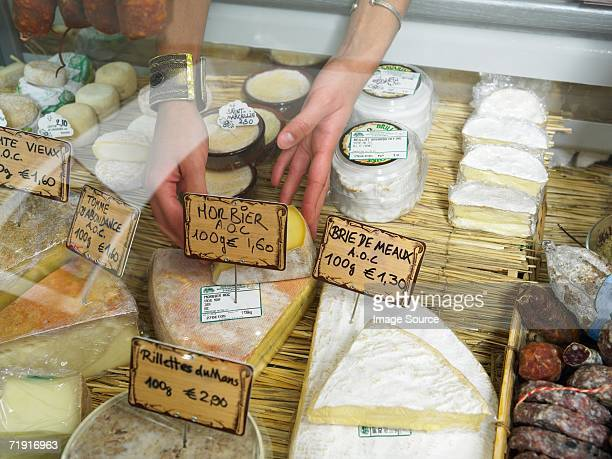 Woman reaching into delicatessen display