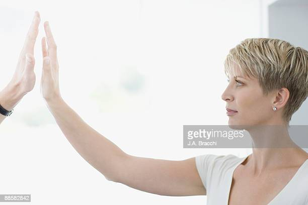Woman reaching out to touch mans hand