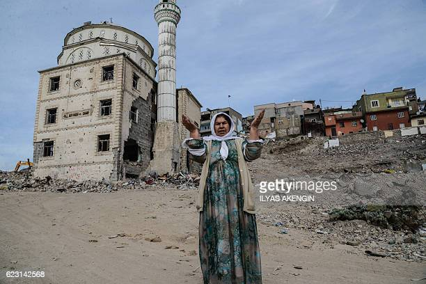 TOPSHOT A woman reacts as she arrives to Sirnak city on November 14 2016 after a 246day curfew was partially lifted The curfew in Sirnak a city of...