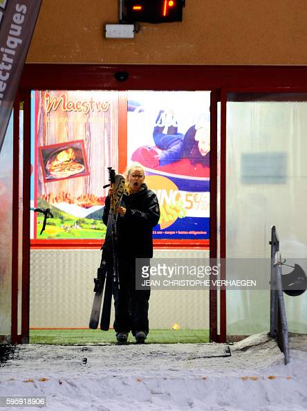 A woman reacts as she enters the Snowhall the only indoor ski run in France in Amneville eastern France on August 26 2016 as a heatwave strikes all...