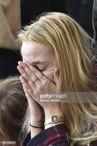 A woman reacts as she mourns the dead at a makeshift memorial near the Bataclan concert hall in Paris on November 15 two days after a series of...