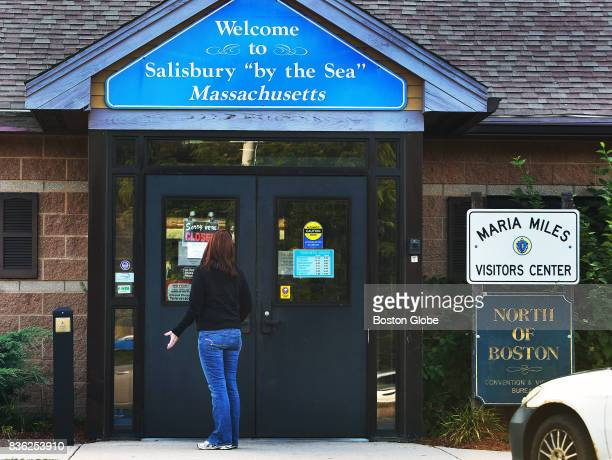 A woman reacts as she reads the 'Sorry We're Closed' sign on the door of a rest stop off of Route 95 southbound in Salisbury Mass Aug 16 2017