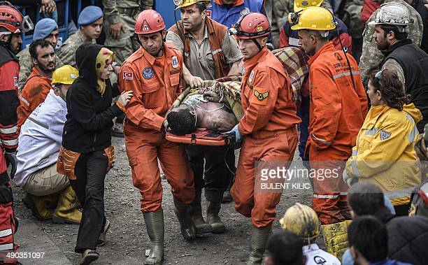 A woman reacts as she searches for relatives while rescuers carry out dead miners on May 14 2014 after an explosion and fire in a coal mine in the...