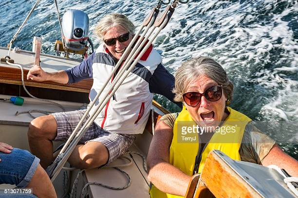 Woman Reacts as the Sailboat Leans Due to Wind