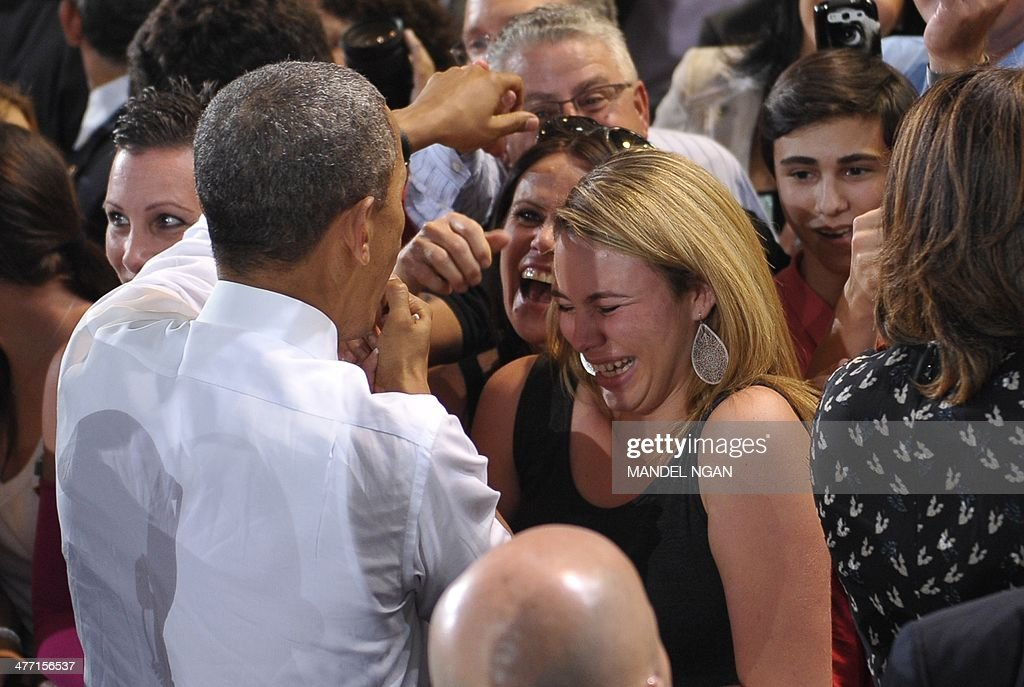 A woman reacts as US President Barack Obama greets attendees after speaking at Coral Reef High School in Miami, Florida on March 7, 2014. AFP PHOTO/Mandel NGAN