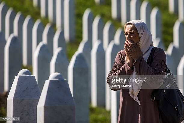 A woman reacts at the Potocari cemetery and memorial near Srebrenica on July 10 2015 in Srebrenica Bosnia and Herzegovina The newlyidentified remains...