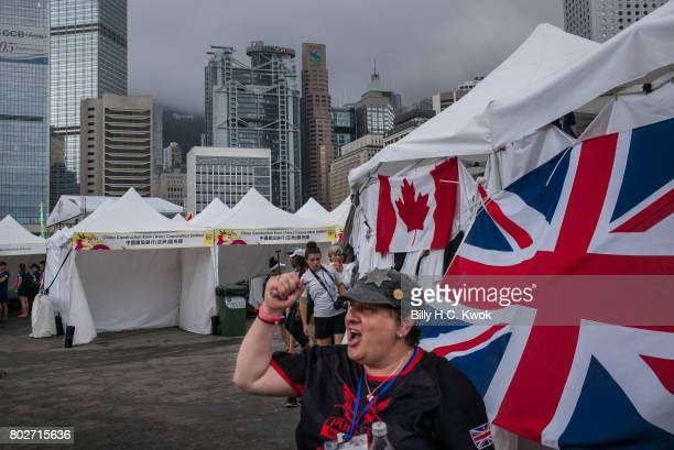 A woman reacts in front of the Britain flag on June 2 2017 in Hong Kong Hong Kong Hong Kong is marking 20 years since the territory was handed from...