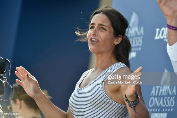 A woman reacts in the Kiss and Cry as Jérome Guery of Belgium riding Gardfield de Fiji Des Templiers competes during the Longines Grand Prix Athina...