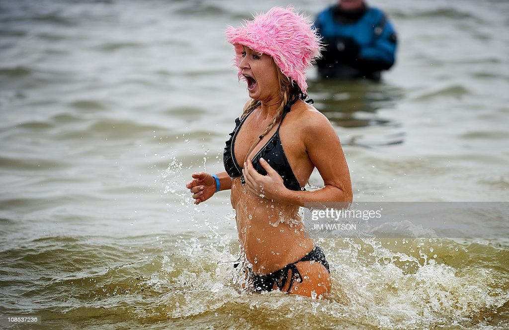 A woman reacts to the cold water of the Chesapeake Bay at Sandy Point State Park in Annapolis MD January 29 during the 15th Annual MSP Polar Bear...