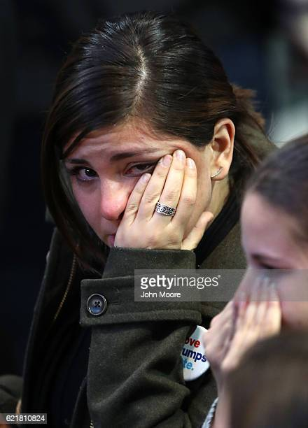 A woman reacts to the voting results at Democratic presidential nominee former Secretary of State Hillary Clinton's election night event at the Jacob...